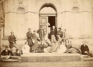 Orchardleigh Estate - The Duckworth family at the entrance of Orchardleigh in 1867. Herbert Duckworth is on the left with the gun. Julia is sitting on the step beside him