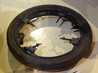 Spare tire - A Stepney rim. An early approach to providing a car with a spare tire