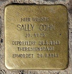 Photo of Sally Cohn brass plaque