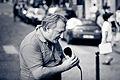 Street music. Quai d'Orléans, Paris September 2011.jpg