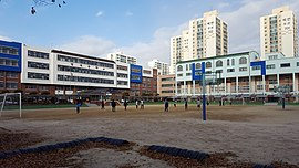 Students Playing Soccer in Bumgye Middle School.jpg