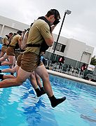 Students enter the pool at the Combat Dive Qualification Course at the Special Forces Underwater Operations School