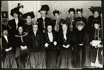 Suffrage Alliance Congress with Millicent Fawcett presiding, London 1909. Top row from left: Thora Daugaard (Denmark), Louise Qvam (Norway), Aletta Jacobs (Netherlands), Annie Furuhjelm (Finland), Madame Mirowitch (Russia), Kathe Schirmacher (Germany), Madame Honneger, unidentified. Bottom left: Unidentified, Anna Bugge (Sweden), Anna Howard Shaw (USA), Millicent Fawcett (Presiding, England), Carrie Chapman Catt (USA), F. M. Qvam (Norway), Anita Augspurg (Germany). Suffrage Alliance Congress, London 1909.jpg