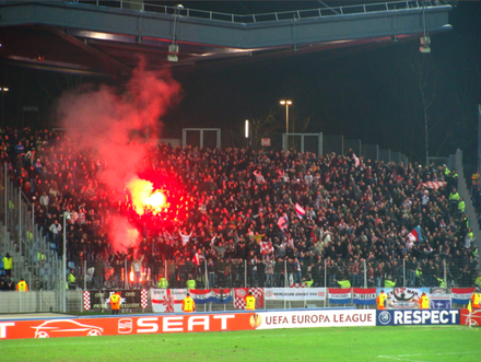 This photo of a match in Lille shows the use of flares by PSV Eindhoven supporters in football hooliganism. Supporters LOSC vs PSV Eindhoven.png