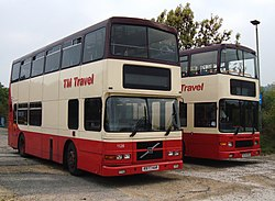 TM Travel buses 1128 (R977 KAR) & 1204 (P274 PSX), 16 October 2010.jpg