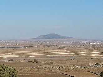 Hauran - The Tel al-Hara volcanic cone in the Jaydur region of the Hauran plain, as seen from the Golan Heights to the west