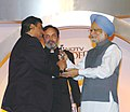 The Prime Minister, Dr. Manmohan Singh giving away Global Indian Award to Shri Mukesh Ambani at the first NDTV Profit Business Leadership Award function, in New Delhi on July 28, 2006.jpg