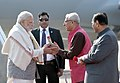 The Prime Minister, Shri Narendra Modi being received by the Governor of Gujarat, Shri O.P. Kohli and the Chief Minister of Gujarat, Shri Vijay Rupani, on his arrival, at Ahmedabad, Gujarat on January 17, 2018.jpg