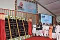 The Prime Minister, Shri Narendra Modi unveiling the foundation stone of the AIIMS Gorakhpur & for the revival of Gorakhpur Fertilizer plant, at Sports Ground, FCI, in Gorakhpur, Uttar Pradesh.jpg