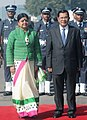 The Prime Minister of Cambodia, Mr. Hun Sen being received by the Minister of State for Urban Development, Smt. Deepa Dasmunsi on his arrival at the Air Force Station, Palam, in New Delhi on December 19, 2012.jpg