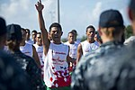 The Samoan Don Bosco Long Boat Rowing Team performs a friendly ritual on the flight deck aboard the amphibious dock landing ship USS Pearl Harbor (LSD 52) after accepting a long boat race challenge from U.S 130604-N-WD757-828.jpg