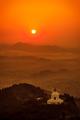 The Shanti Stupa at sunrise.png