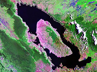 Caldera - Landsat image of Lake Toba, on the island of Sumatra, Indonesia (100 km/62 mi long and 30 km/19 mi wide, one of the world's largest calderas). A resurgent dome formed the island of Samosir.