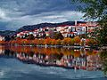 Traditional red roof houses reflected in Kastoria lake, Greece.jpg