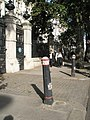 Traffic bollards and pavement on Victoria Embankment, London.jpg