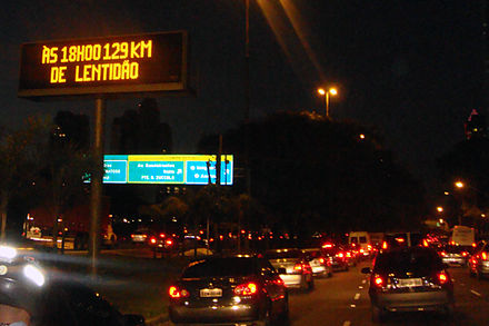 Traffic congestion on Marginal Pinheiros, near downtown São Paulo. According to Time magazine, São Paulo has the world's worst traffic jams.[110] Drivers are informed through variable message signs the prevailing queue length.