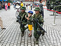 Two ROCA Soliders Kneeling on Ground with Boy 20140607.jpg