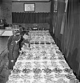 Two members of the Women's Auxiliary Air Force stop an RAF corporal from helping himself to food prepared for a midnight cabaret at the RAF depot, Uxbridge in 1944. D22228.jpg