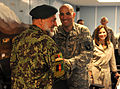 U.S. Army Col. Andrew Poppas, center, commander of Task Force Bastogne, greets Brig. Gen. Mohammad Afzal, commander of the Afghan National Army's 2nd Brigade, before discussing security for the upcoming 100831-A-RN448-003.jpg
