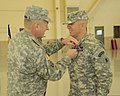 U.S. Army Col. Michael Berry, right, receives the Meritorious Service Medal from Brig. Gen. Scott E. Chambers, the assistant adjutant general of the Delaware National Guard, for his services during his command 131207-Z-GL773-812.jpg