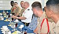 U.S. Army Gen. Martin E. Dempsey, the chairman of the Joint Chiefs of Staff, talks to Recruit Training Command staff members during lunch at a command barracks called the USS Arizona Sept 140905-N-IY426-020.jpg