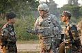 U.S. Army Lt. Col. Jim Isenhower talks with Indian Army officers following an early morning exercise.jpg