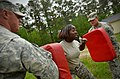 U.S. Army Sgt. Latoya Simmons, center, with the 1132nd Military Police Company, North Carolina Army National Guard, makes her way through a defense course during oleoresin capsicum familiarization training 130501-Z-AY498-011.jpg