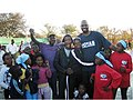 U.S. Embassy Pretoria Political Officer Freeman With South African Children.jpg