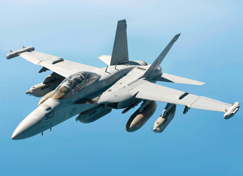 U.S. Navy EA-18G Growler breaks away from a U.S. Air Force KC-135 (altered).jpg