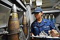 U.S. Navy Gunner's Mate 2nd Class Patricia Capers, assigned to the guided missile cruiser USS Antietam (CG 54) inspects ammunition rounds Oct. 2, 2013, while underway in the Sea of Japan 131002-N-TG831-005.jpg