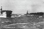 USS Lunga Point (CVE-94) and USS Makin Island (CVE-93) in a Western Pacific storm off Wakayama, Japan, circa 3-7 October 1945.jpg