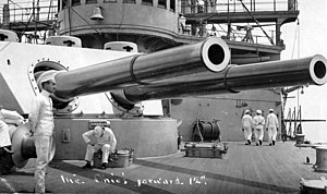"12""/40 caliber gun - 12""/40 guns of the ship's forward gun turret, photographed circa 1907-1908. Note Sailors strolling on deck; bell mounted on the pilothouse face; and 3-pounder guns mounted on the superstructure."