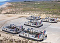 US Navy 030117-N-5067K-006 Landing Craft Air Cushion (LCAC) vehicles from Assault Craft Unit Five (ACU-5) stand by to transport their cargo of Light Armored Vehicles (LAV's) from elements of 1st and 3rd Light Armored Reconnaiss.jpg