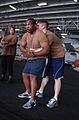 US Navy 030409-N-4953E-566 Master-at-Arms 2nd Class Rajohn Revies gives training on hand-to-hand defensive tactics.jpg