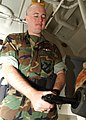 US Navy 030419-N-9239W-003 Air Traffic Controller Airman Benjamin Whitfield, of Deerpart, Texas, safety checks a 9mm pistol.jpg