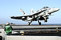 US Navy 040628-N-0119G-031 An F-A-18 Hornet launches back into the air after conducting a touch and go landing.jpg