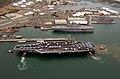 US Navy 040629-N-7498B-052 Tugboats assist the Nimitz-class aircraft carrier USS John C. Stennis CVN 74.jpg