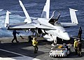 US Navy 040811-N-0057P-014 Sailors assigned to the aircraft carrier USS Abraham Lincoln (CVN 72) secure an F-A-18C.jpg