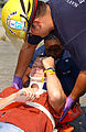 US Navy 040824-N-3644C-005 Firefighter-Emergency Medical Technician (EMT) Jason Erwin carefully places simulated victim, Andrew Kaeding, onto a stretcher during a recent mass casualty drill on board Naval Air Station Oceana.jpg