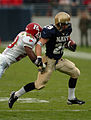 US Navy 041120-N-9815L-010 Rutgers University defensive back Jarvis Johnson tackles U.S. Naval Academy Midshipman 2nd Class Marco Nelson on a rushing attempt.jpg
