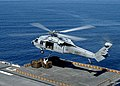 US Navy 050204-N-0050M-001 An MH-60S Knighthawk hovers above the flight deck of the amphibious assault ship USS Saipan (LHA 2).jpg