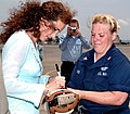 US Navy 050614-N-3983C-002 Actress Andie MacDowell autographs a patch for Aviation Electrician's 2nd Class Laura Delaughter, during a tour on board Naval Air Station Sigonella, Sicily.jpg