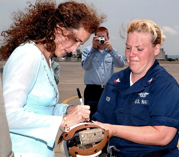 File:US Navy 050614-N-3983C-002 Actress Andie MacDowell autographs a patch for Aviation Electrician's 2nd Class Laura Delaughter, during a tour on board Naval Air Station Sigonella, Sicily.jpg