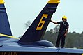 US Navy 050916-N-0295M-186 A crew chief assigned to the U.S. Navy flight demonstration team, the Blue Angels, performs a post engine run-up inspection on the top surfaces of one of the Blue Angel's F-A-18A Hornets.jpg