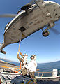US Navy 060411-N-0716S-032 Staff Sgt. Nathaneal Hart attaches a cargo pendant to an MH-60S Seahawk helicopter,.jpg
