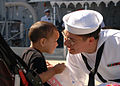 US Navy 060504-N-1928H-180 Damage Control Fireman Tyler Howard meets his son for the first, after returning from deployment aboard the amphibious dock landing ship USS Carter Hall (LSD 50).jpg