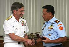 US Navy 070308-N-1113S-001 Commander U.S. 7th Fleet Vice Adm. Doug Crowder and Commander-in-Chief of National Defense Forces Republic of Indonesia Air Chief Marshal Djoko Suyanto shake hands.jpg