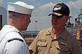 US Navy 070605-N-6081J-041 Commander, U.S. Fleet Forces Command (FFC), Adm. Gary Roughead, speaks with a Sailor aboard the Military Sealift Command (MSC) hospital ship USNS Comfort (T-AH 20) during a pre-deployment visit.jpg