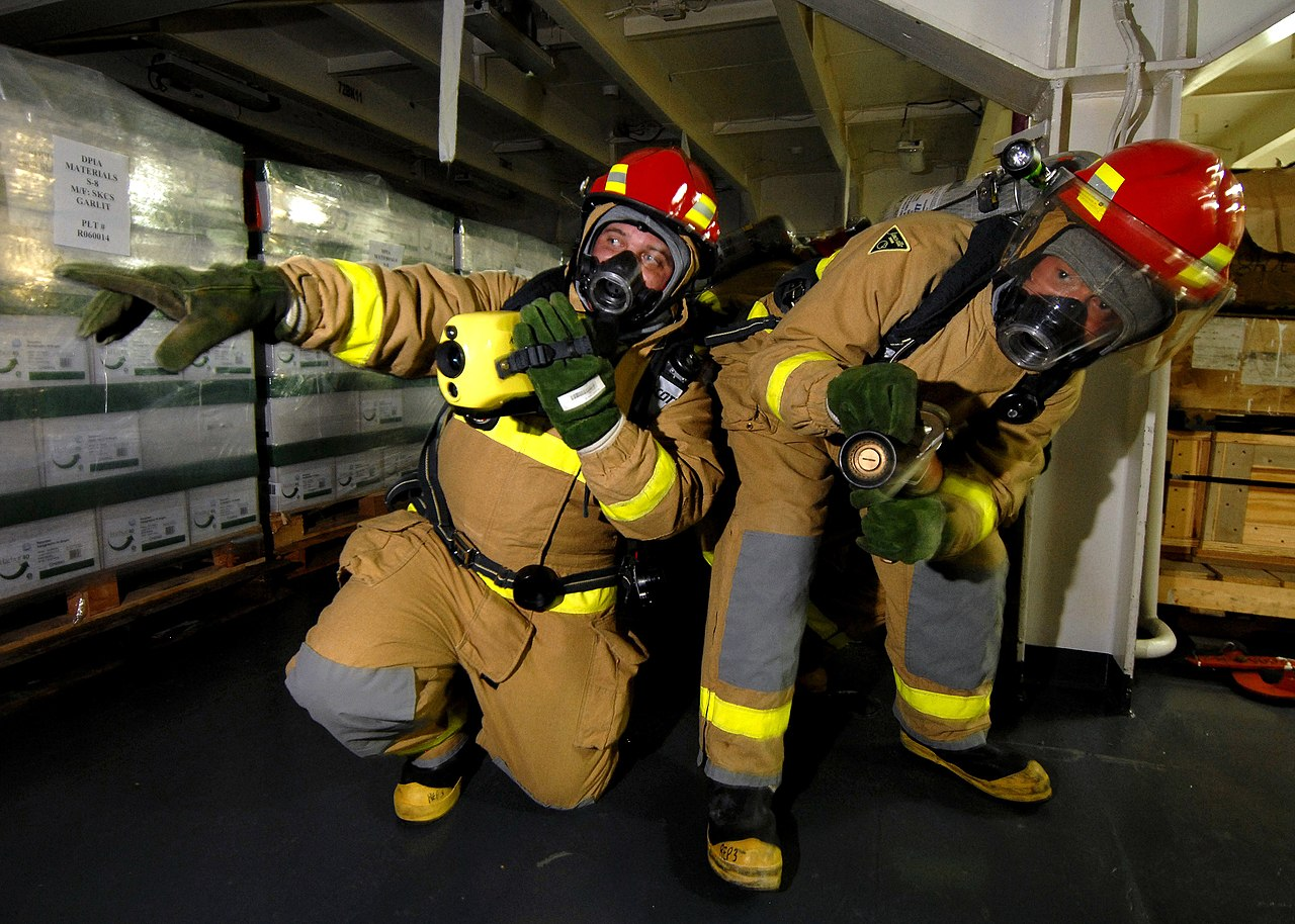 file us navy n e a hose team leader assigned to file us navy 070624 n 7981e 152 a hose team leader assigned to repair locker three uses a naval firefighter s thermal imager nfti to direct a nozzleman to