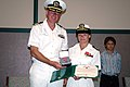 US Navy 070714-N-8102J-011 Cmdr. Kelly Nielsen receives the Bronze Star Medal from Cmdr. Joseph Sweeney, commanding officer of Naval Air Systems Command 0466 Det. A.jpg
